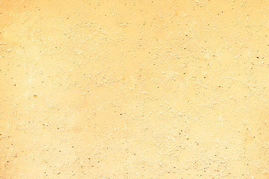 light yellow golden grunge textured background. Sandstone vintage wall