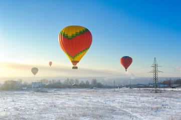 Hot Air Balloon Flying Over Snow Against Sky