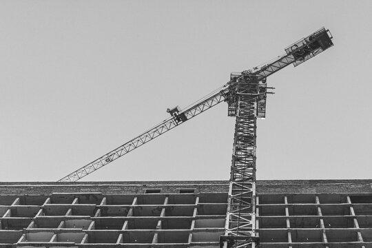 high construction crane. construction of a concrete residential building.
