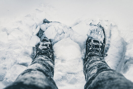 person in snow. snow-covered boots.