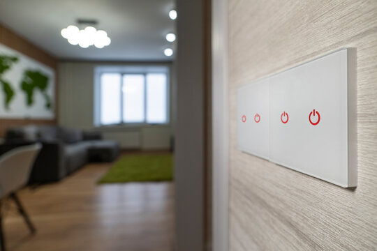 white modern light switch on a white wall on the background of the living room. modern design.