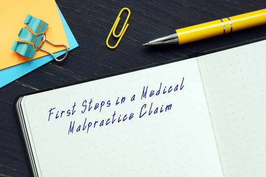 First Steps in a Medical Malpractice Claim inscription on the piece of paper.