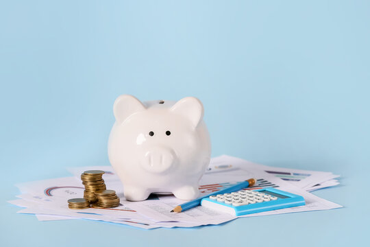 Piggy bank with savings, calculator and documents on color background. Concept of pension