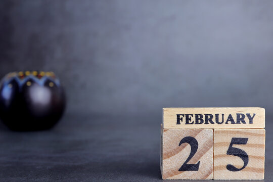 Day 25 of february month, Wooden calendar with date. Empty space for text.