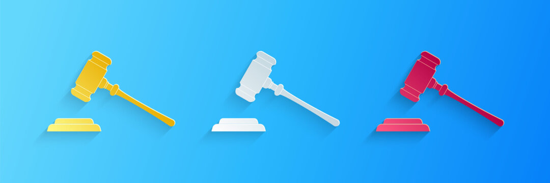 Paper cut Judge gavel icon isolated on blue background. Gavel for adjudication of sentences and bills, court, justice, with a stand. Auction hammer. Paper art style. Vector.