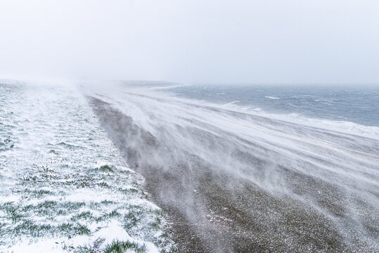 White-out blizzard snow storm on a sea dike in Den Helder, Holland, Netherlands