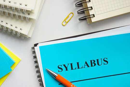 Syllabus educational plan and papers on the desk.