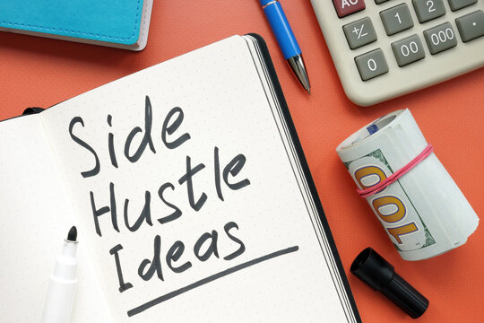 Side hustle ideas list and cash on the desk.
