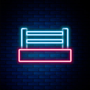Glowing neon line Boxing ring icon isolated on brick wall background. Colorful outline concept. Vector.