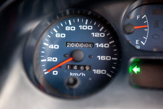 Car dashboard odometer showing 200,000 miles