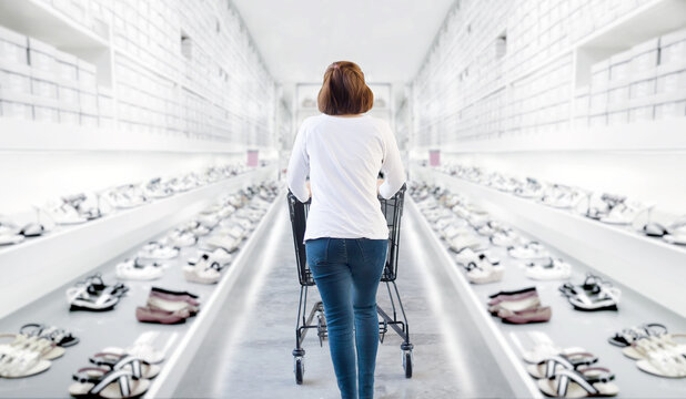 Rear View Of Woman Walking In Shoe Store With Shopping Cart