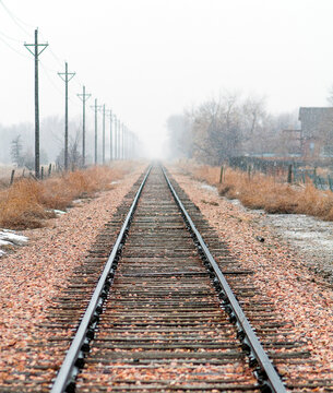 View Of Railroad Tracks Against Sky During Winter