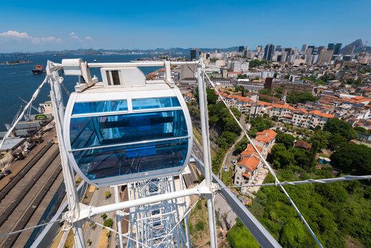 Rio de Janeiro, Brazil - January 19, 2021: Rio Star ferris wheel cabin with city view behind.