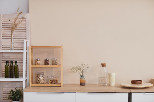Graphic background image of minimal kitchen interior with pastel colored wall and floral accents, copy space