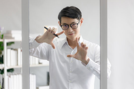 A businessman planning a marketing plan with his team. Professional teachers write on the glass board to teach. Young doctor is planning a treatment with the team.
