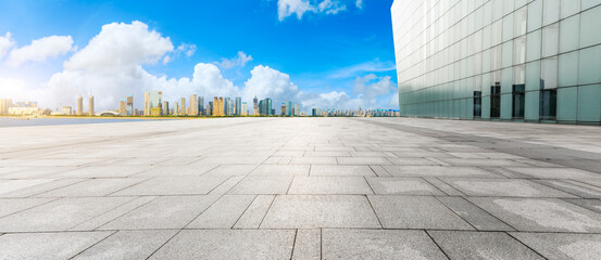 Empty square floor and modern city skyline with buildings in Hangzhou.
