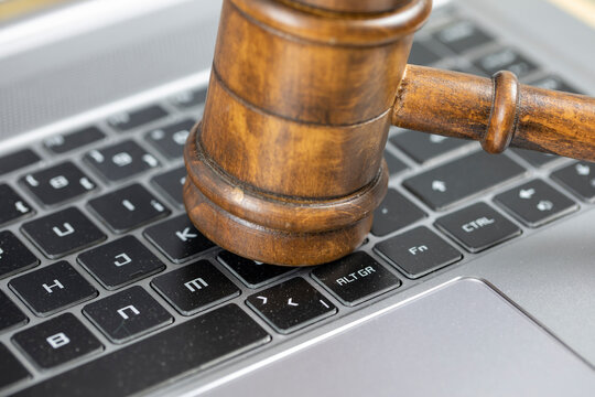 Social media and cyber crime concept, Justice gavel on laptop computer keyboard