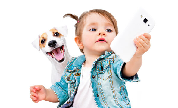 Little cute girl makes selfie with  dog Jack Russell Terrier on phone isolated on white background