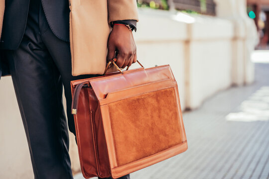 Business man holding a briefcase.