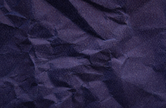 Rustic blue crumpled paper texture making a perfect background