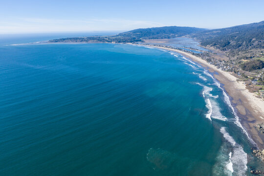 North of San Francisco, the Pacific Ocean washes against the shoreline of Stinson Beach on a beautiful winter day. The scenic Pacific Coast Highway runs along much of the edge of California.