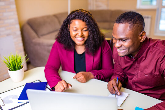african american woman and man in home office in living room start up