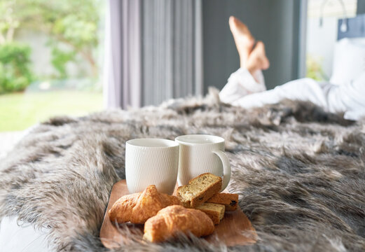 Coffee and croissants and biscotti on morning bed