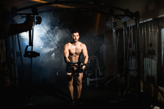 Muscular Fitness Bodybuilder Doing Heavy Weight Exercise In The Gym. Athlete doing pectoral muscle exercise
