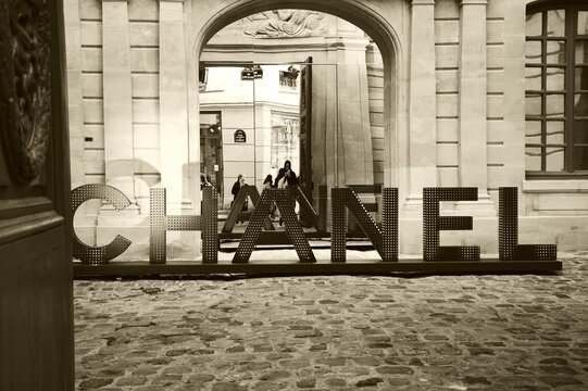PARIS, FRANCE - JANUARY 28, 2017: Chanel shop in old Marais quarter. Chanel fashion house founded by Coco Chanel is symbol of haute couture and luxury goods.  Sepia historic photo
