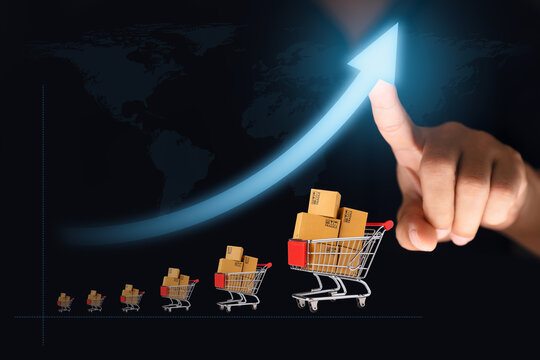 Online shop growing concept, ecommerce marketplace, Web online shopping and delivering, Finger pointing at arrow and shopping cart