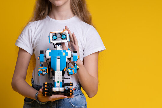 Minsk, Belarus. January 2021. A teenage girl holds Lego Boost robot. It is a best toy for kids. STEM and STEAM education. DIY. AI.