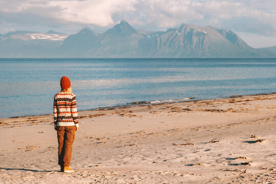 Woman traveling in Norway walking on sandy beach active healthy lifestyle vacations outdoor girl enjoying mountains and sea view