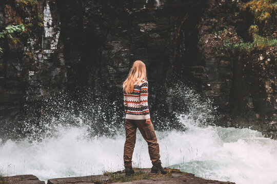 Woman traveler hiking in Sweden traveling alone adventure trip active vacations healthy lifestyle girl enjoying river canyon view water splash