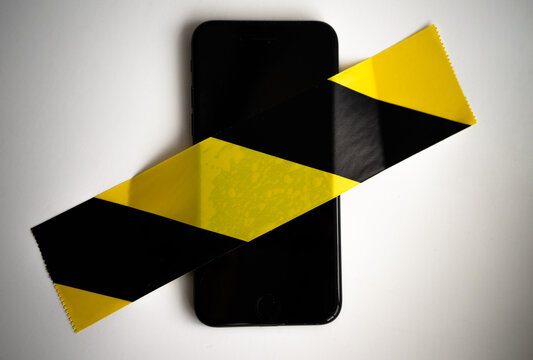 The smartphone is sealed with a forbidding film of black and yellow color. Calls are not allowed.