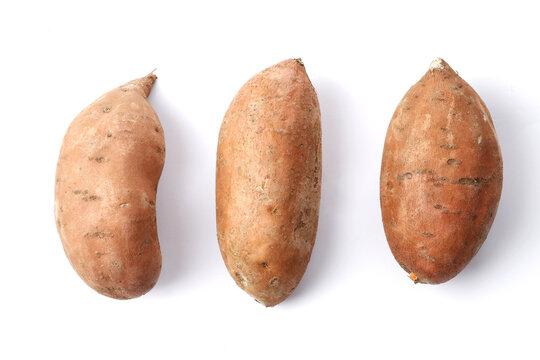 Fresh ripe sweet potatoes on white background