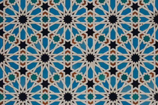 Seville, Spain - January 19, 2020: Tiles with Mudejar motif in the Alcazar of Seville Palace in Seville, Spain.