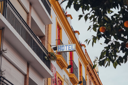 Seville, Spain - January 19, 2020: Hotel sign on colourful building on a Plaza De San Andres in Seville, Spain.