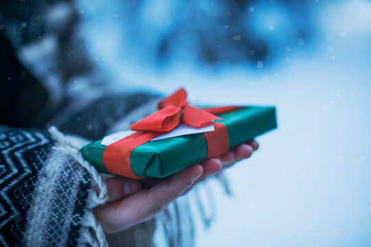 Close-Up of a woman holding a wrapped Christmas gift