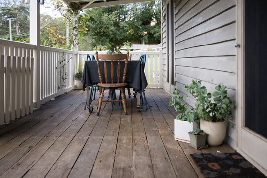 Outdoor seating and dining on vintage rustic cottage home