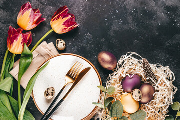 Table setting for celebrating easter, top view, free space for text