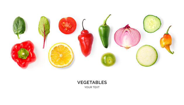 Creative layout made of tomato, onion, pepper, cucumber and zucchini on the white background. Flat lay. Food concept.