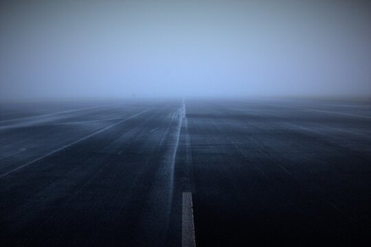 Runway During Foggy Weather
