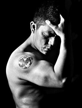 Close-up Of Shirtless Body Builder Against Black Background