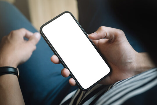 Top view man sitting and holding blank screen mock up mobile phone