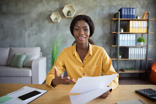 Photo of young dark skin woman hold resume talk webcam interview employer indoors in office workstation