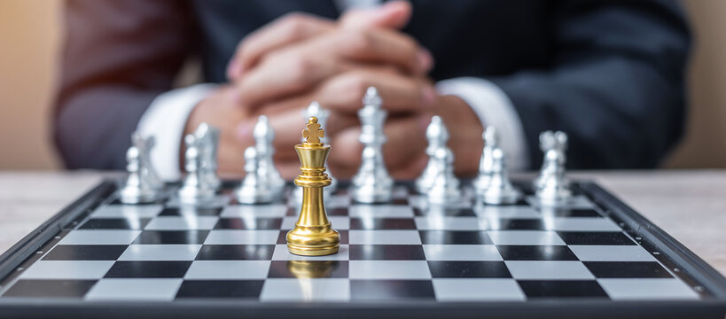 hess King figure against chessboard opponent with businessman manager background. Strategy, Success, management, business planning, tactic, politic, thinking, vision and leadership concept