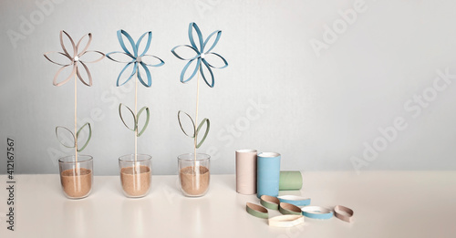Flowers from toilet roll tube for Mother Day, zero waste crafts for kids, school and kindergarten, creative seasonal idea for holidays and leisure, plain neutral pastel background
