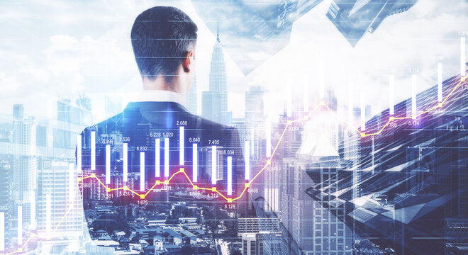 Business analytics concept with back of businessman at city background and digital screen with glowing stock market graphs. Double exposure.