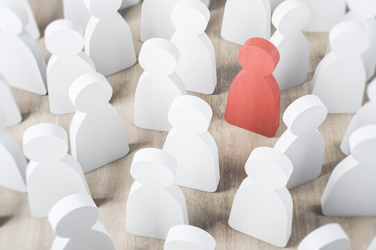 Leadership and success concept with red wooden figure as an influence leader in a crowd of white wooden figures as followers leaders opinion on wooden table. Business team concept. 3D rendering