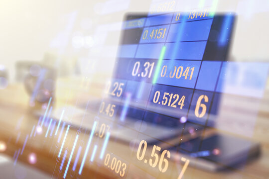 Multi exposure of abstract financial graph and modern desktop with pc on background, financial and trading concept